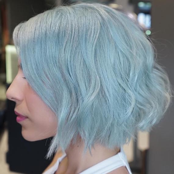 Side profile of woman with aqua blue bob hairstyle, created using Wella Professionals.