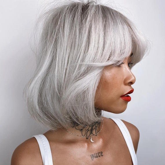 Side profile of woman with ice blonde bob hairstyle, created using Wella Professionals.
