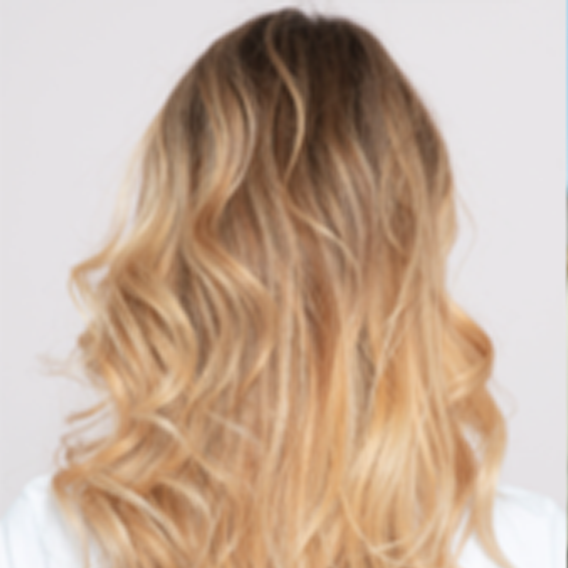 Back of a woman's head with blonde hair and balayage, created using Wella Professionals.