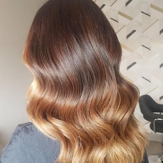 Back of woman's head with long, wavy, brown ombre hair, created using Wella Professionals.