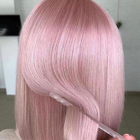 Back of woman's head with short, baby pink hair, created using Wella Professionals.