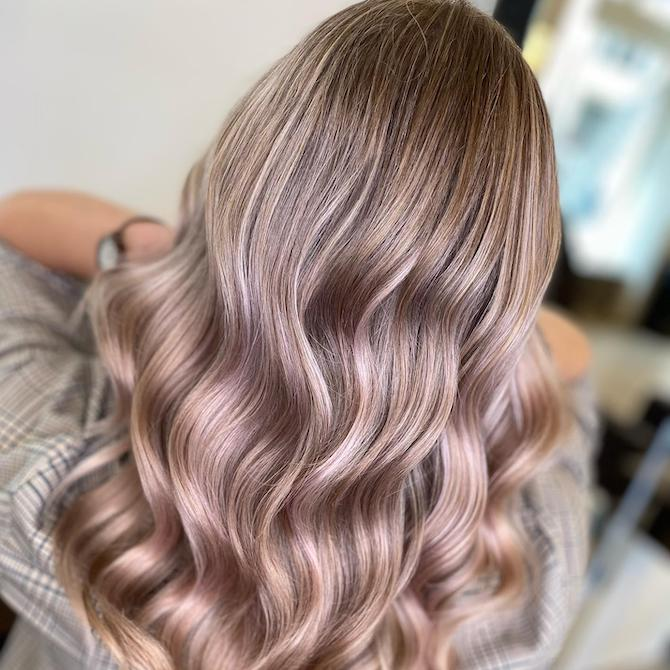 Back of woman's head with ash blonde hair and pink highlights, created using Wella Professionals.