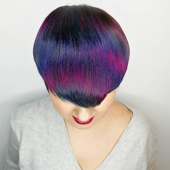 Photo of woman with pixie crop and peacock hair color, created using Wella Professionals.