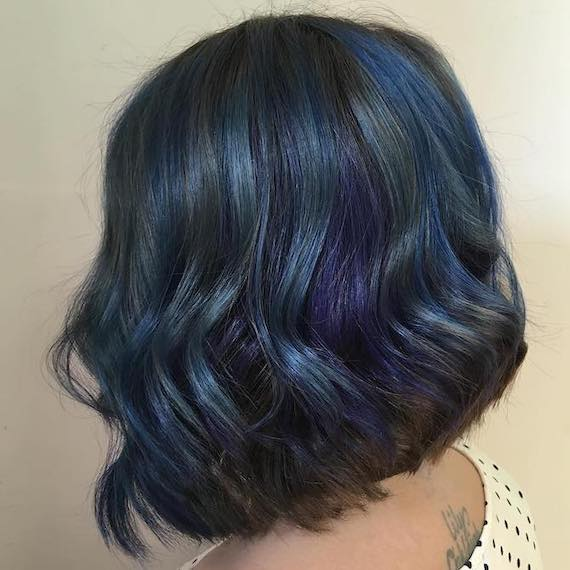Side profile of woman with short bob and peacock hair color, created using Wella Professionals.