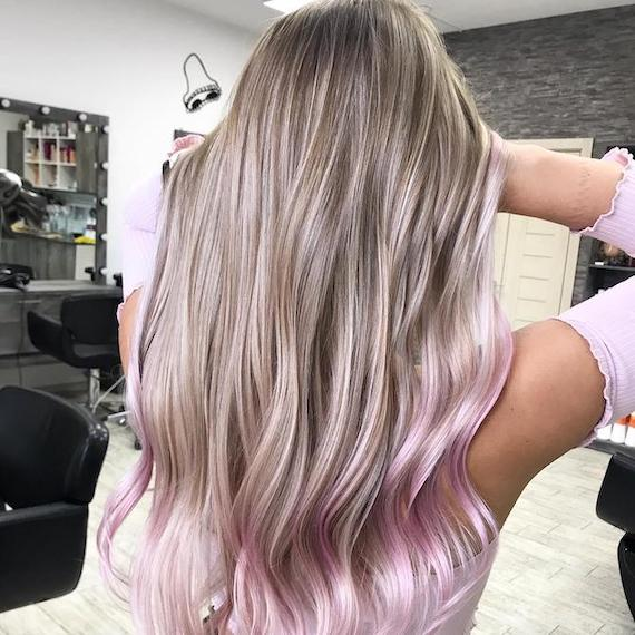 Back of woman's head with long, straight, blonde hair and pink tips, created using Wella Professionals.
