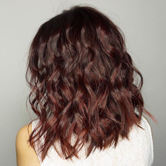 Side profile of woman with short, tousled, red brown hair, created using Wella Pro-fessionals.