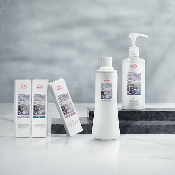 Bottles from Wella's Silver Glow by True Grey collection.