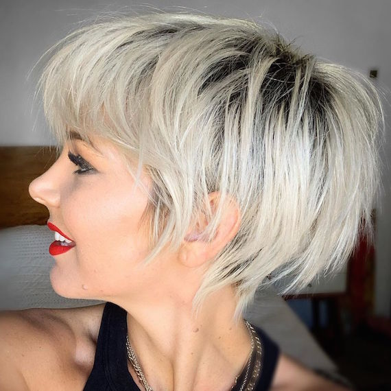 Side profile of woman with blonde pixie crop and undercut, created using Wella Professionals.