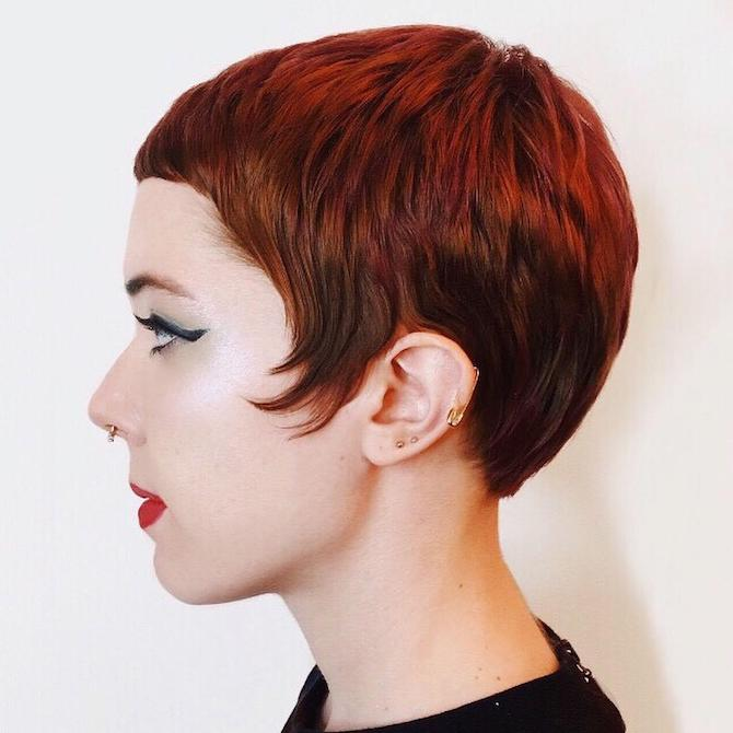 Side profile shot of woman with long pixie cut hairstyle, created using Wella Professionals