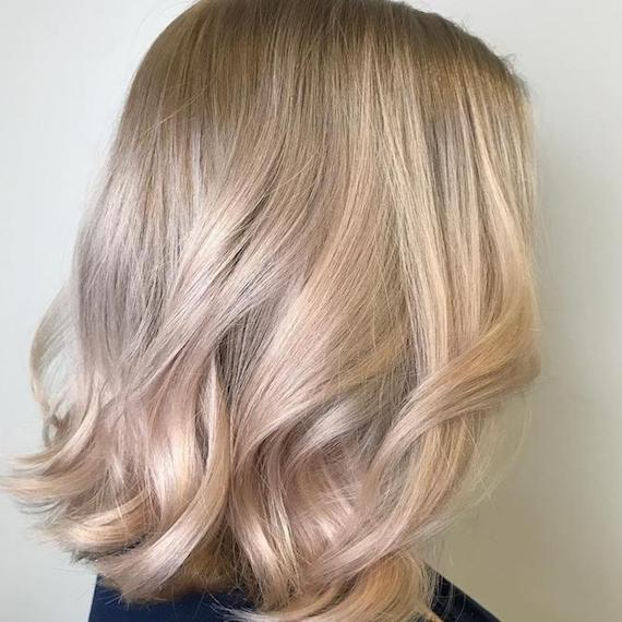 Side profile of model with short, cool blonde hair and subtle highlights, created using Wella Professionals.