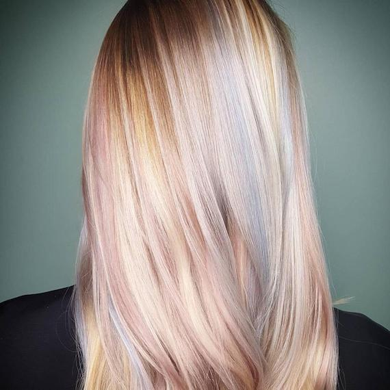 Model with blonde, straight hair and subtle pastel highlights, created using Wella Professionals.