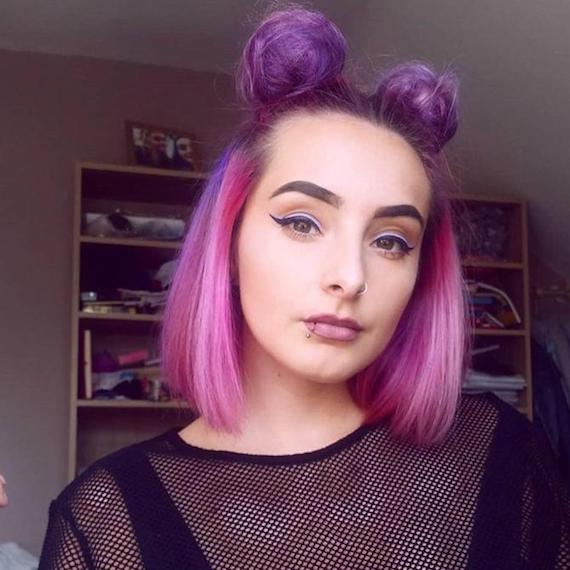 Woman with pink and purple hair tied up in space buns, styled using Wella Professionals