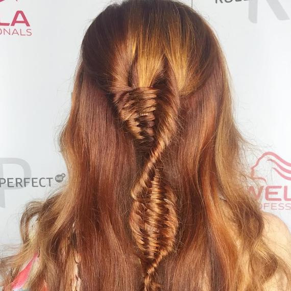 Back of a woman's head showing hair twisted into a DNA braid, styled using Wella Professionals