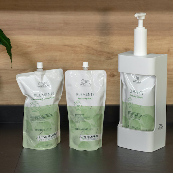 Wella's Elements Renewing Mask and Conditioner in pouches and Renewing Shampoo in a pump.
