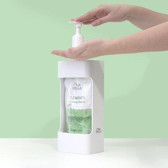 Elements Renewing Shampoo is squeezed from a pump.