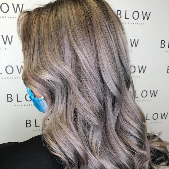 Back of woman's head with silver blonde hair, created using Wella Professionals.