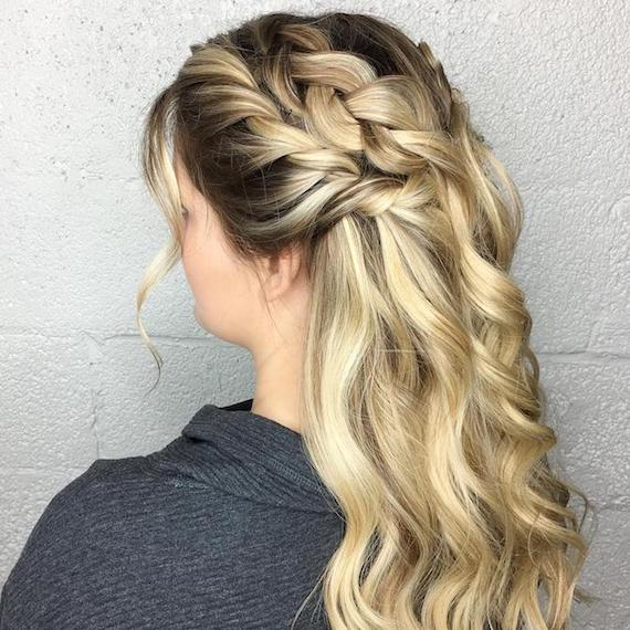 Photo of woman with hair styled in a braided half-updo for her wedding hairstyle, created using Wella Professionals