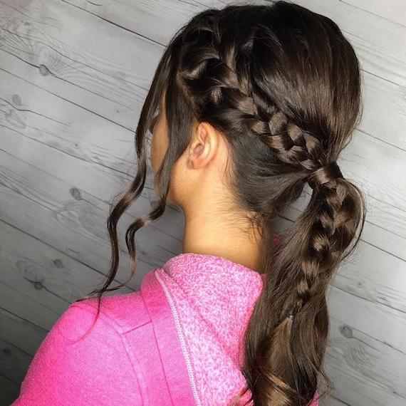 Photo of woman with hair styled in a braided ponytail for her wedding hairstyle, created using Wella Professionals
