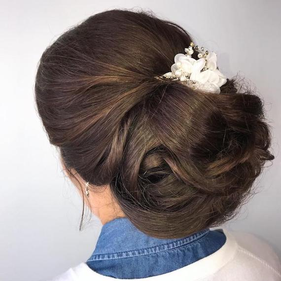 Photo of the back of a woman's head with hair styled in a wedding chignon, created using Wella Professionals
