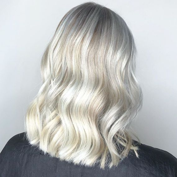 Photo of the back of a woman's head with ice blonde hair color. Look created by Wella Professionals.