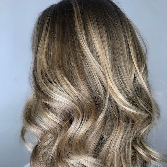 Photo of woman's hair with iced latte hair color. Look created by Wella Professionals.