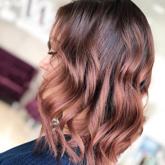Photo of woman's hair with rose brown hair color. Look created by Wella Professionals.