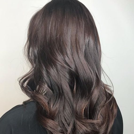 Photo of woman's hair with bitter chocolate brown hair color. Look created by Wella Professionals.