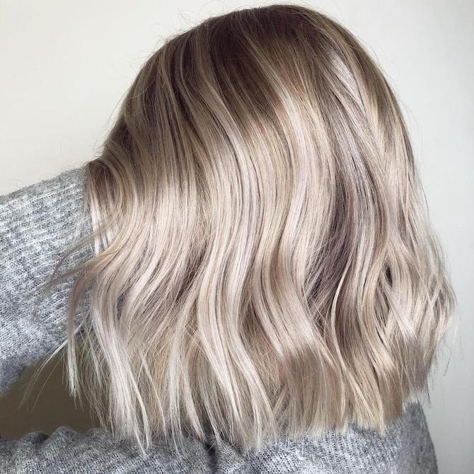 Side profile shot of woman with wavy, ash blonde bob, created using Wella Professionals