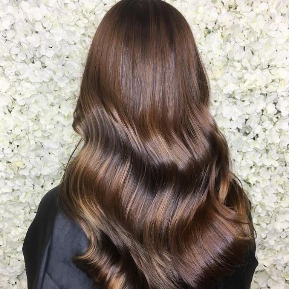 Chocolate brown, curly hair created using Wella Professionals