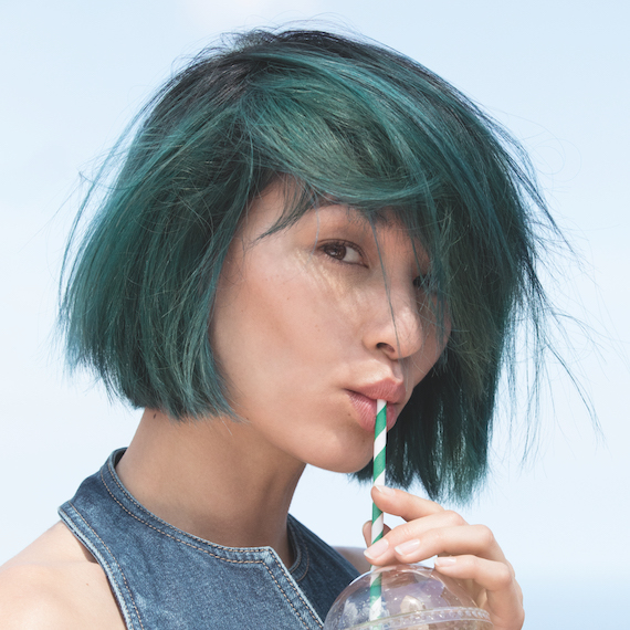 Model wearing green mermaid hair, created by Wella Professionals