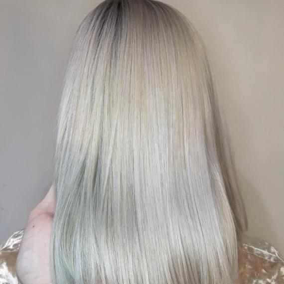 Woman with super-straight, shiny, ice blonde hair, created using Wella Professionals