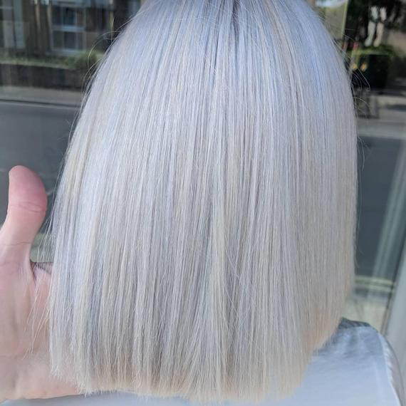 Woman with blunt ice blonde bob haircut, created using Wella Professionals