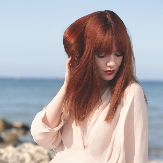 Lifestyle vlogger and author Melanie Murphy wearing Wella Professionals Leather Red hair color