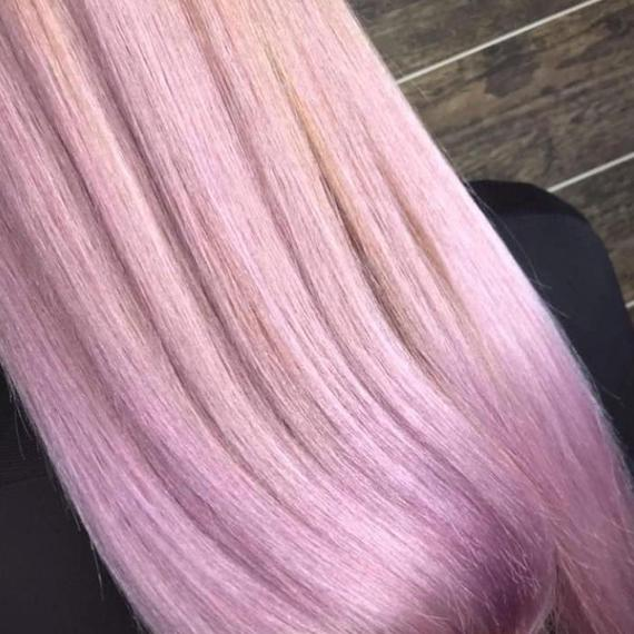 Close-up of metallic pastel pink hair, created using Wella Professionals