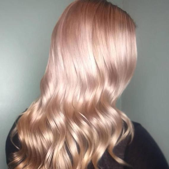 Model with long, pale pink-colored hair, created using Wella Professionals