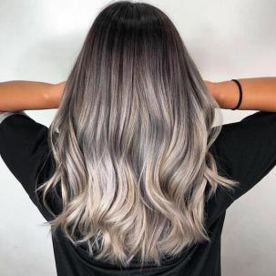 Back of woman's head with long, tousled, silver ombre hair, created using Wella Professionals.