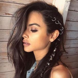 Woman with long brown black hair with the new festival accessory hair rings