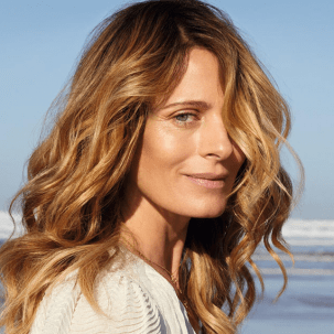 Model with sun-kissed hair, created using Wella Professionals' Illuminage technique.