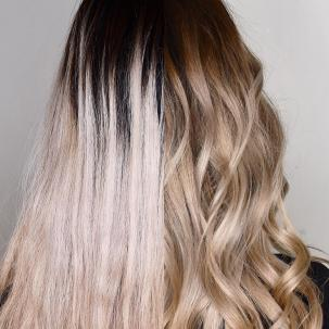 Woman with half wavy and half straight blonde hair