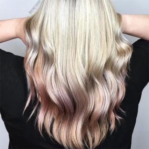 Woman with reverse blonde balayage wavy hair