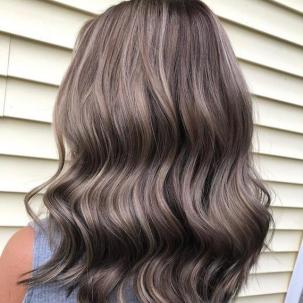 Back of woman's head with ash brown and gray hair, created using Wella Professionals.