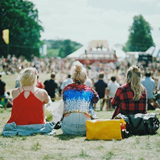 Three women at a festival