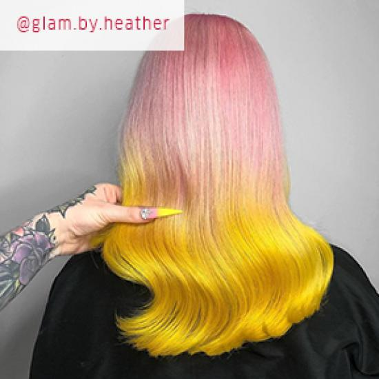 Model with pink and yellow ombre hair, created using Wella Professionals
