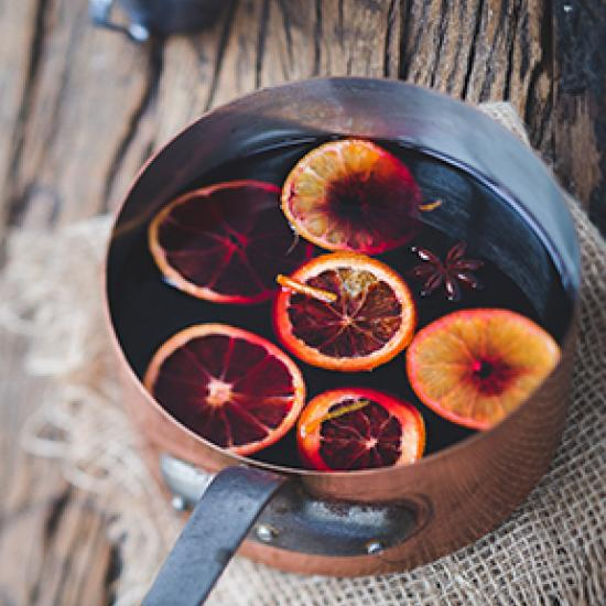 Mulled wine with orange slices in