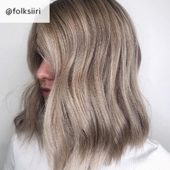Wavy ash blonde hair, created using Wella Professionals