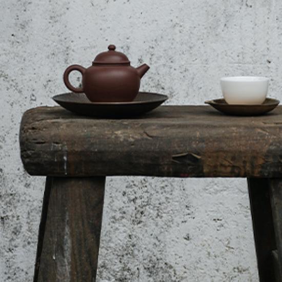 pot of tea on wooden table