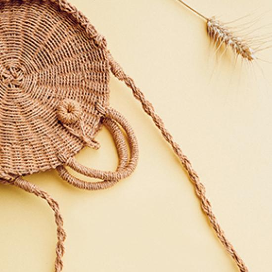 Wicker bag on a cream colored background