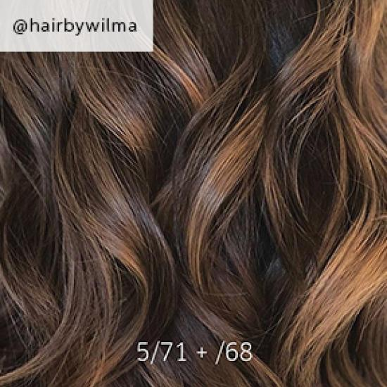 Close-up of dark brown balayage hair, created using Wella Professionals.
