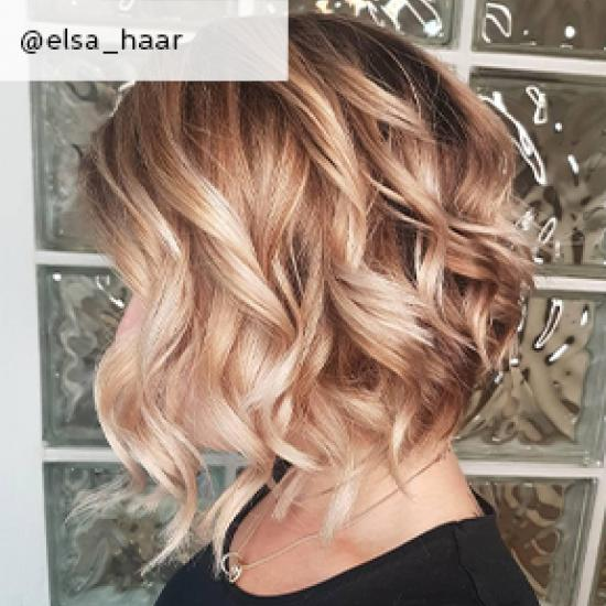 Side profile of woman with curly, blonde balayage bob, created using Wella Professionals.