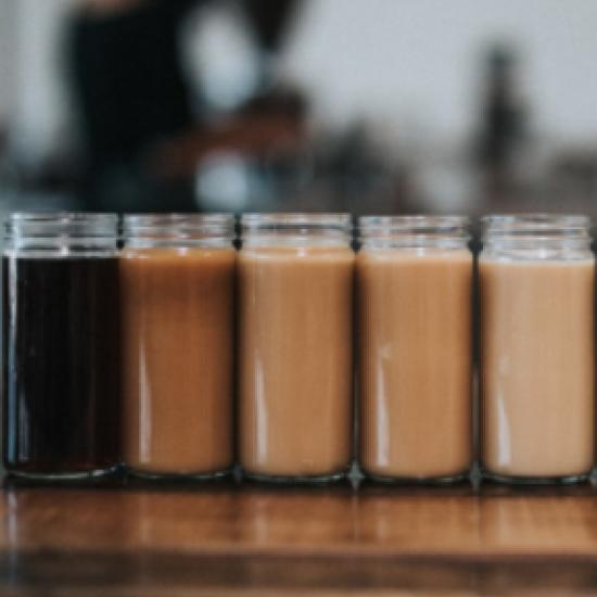 Row of jars filled with coffee.
